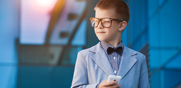 Young child in suit and glasses