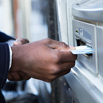 Man inserting card into ATM