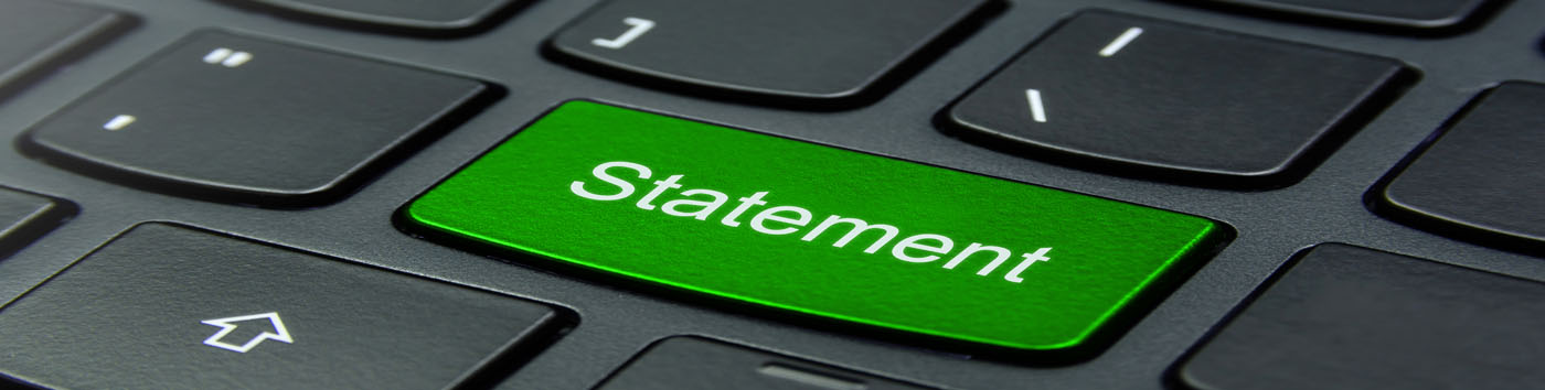 Green button on keyboard that reads Statement
