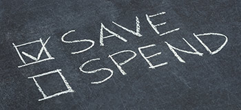 Chalk writing that has a check marked box by the word Save and an empty box by the word Spend