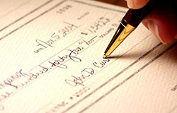 Close-up of signing a check