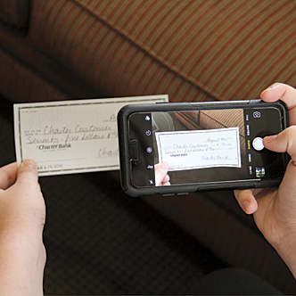 A smart phone taking a picture of a check for remote deposit