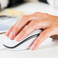 Hand on computer mouse