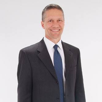 Paul Kohler in business suit smiling