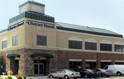 Tan and brick building that reads Charter Bank in Chanhassen