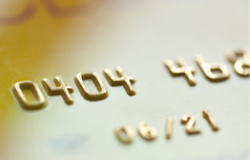 Close-up of gold debit card