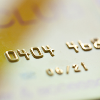 Close up of numbers on a gold credit card