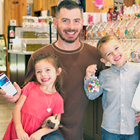 young family at candy shop