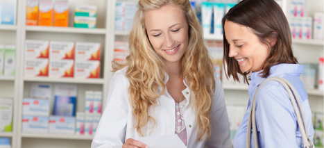 pharmacist talking with smiling patient