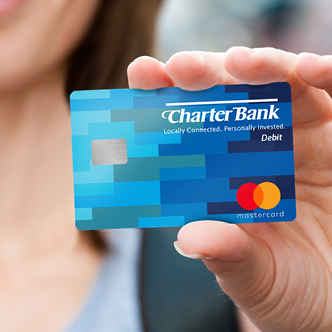woman holding Charter Bank debit card